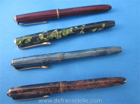 four vintage fountain pens with golden tip