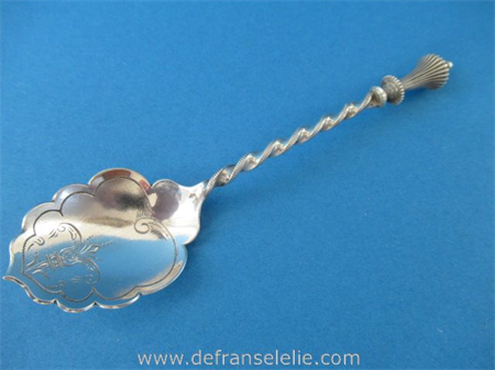 an antique Dutch silver sugar spoon