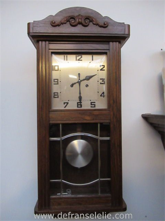 a vintage German oak wall clock